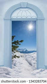view through arched door, mountain landscape winter in the bavarian alps