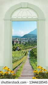 view through arched door, path through vineyard switzerland, view to spiez castle bernese oberland
