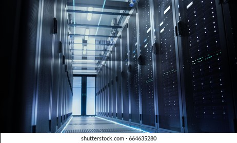 View Through Big Working Data Center with Server Racks.