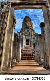 view through door entrance to a statue of bayon temple in angkor wat - Cambodia (HDR)