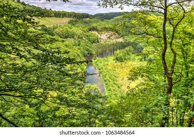 View through the forest near Bouillon in the Ardennes, Belgium, towards the river Semois