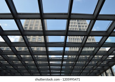 The view through the glass roof with patterns of metro station on Potsdamer Platz in Berlin, Germany with the sky in background, August 2014