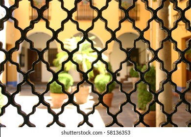 View through grating from wrought iron onto the patio