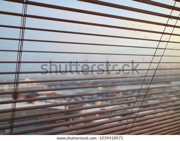 view through jalousie to the industrial zone