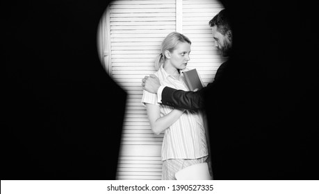 View through keyhole. Boss aggressive threatening violence. Witness of office crime. Woman suffer violence in office. Dirty secret and blackmail. Discrimination and violence. Occupational violence.
