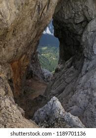 View through the natural window Prisojnikovo okno, Triglav National Park, Slovenia. - Shutterstock ID 1189701136