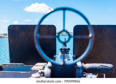 View through the sights of a .50 cal heavy machine gun, aboard USS Missoury, Pearl Harbour, Hawaii