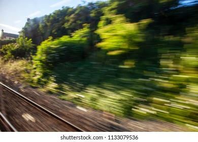 View through the train window. Landscape in a motion blur
