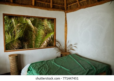 View through the widow of tropical cottage room at mexican jungle