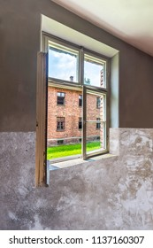 View through window of barrack for women's prisoner in Auschwitz concentration and extermination camp built and operated by Nazi Germany in German-occupied Poland by Third Reich during world war ii