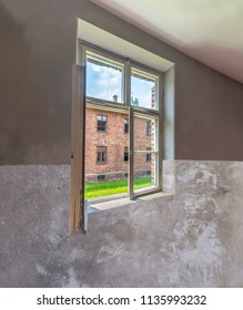View through window of barracks for women's prisoner in Auschwitz concentration and extermination camp built and operated by Nazi Germany in German-occupied Poland by Third Reich during world war ii