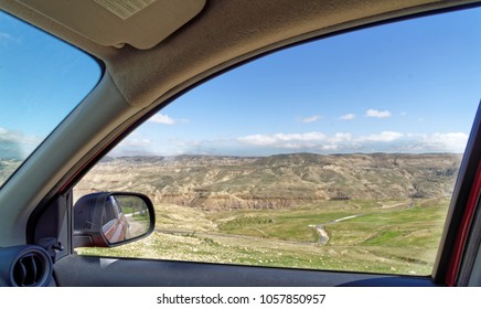 View through the window of a rental car to the edge of Dana Biosphere Reserve, Jordan, middle east