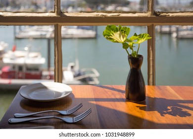 View through the window of the restaurant on the Golden Gate Bridge in San Francisco. Restaurant on the pier in San Francisco. Yachts near the pier in San Francisco.