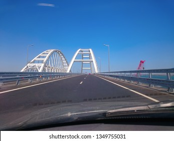 View through the windshield of a moving car. Crimea, Russia - June, 8, 2018: Travel on the Crimean bridge during its construction. View from the car