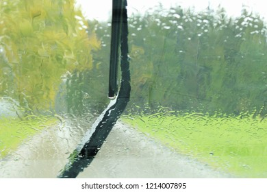 View through a windshield, windshield wiper, on a rainy day on the country side, Bavaria