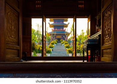 View throw the door to the temple complex Bai Dinh Pagoda in Vietnam in Ninh Binh