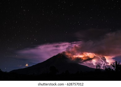 A view of thunderbolt near Mount Sinabung in Indonesia.  Mount Sinabung is one of the most unique volcanoes, many visited by tourists and experts volcano from various countries in the world.