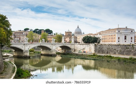 View of Tiber river with St Peter's Basilica and Ponte Vittorio Emanuele II, Rome, Italy