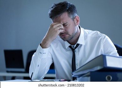 View of tired businessman in the office