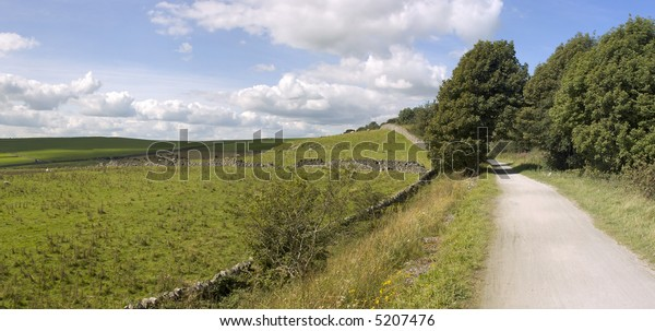 view from the tissington trail cycleway and footpath along disused railway line peak district national park derbyshire england uk