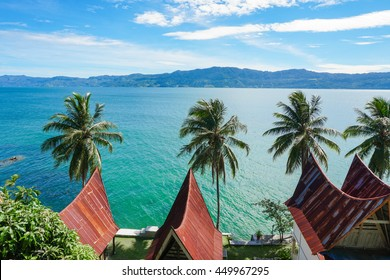 View of Toba lake with traditional batak-style roofs from Samosir island, North Sumatra, Indonesia