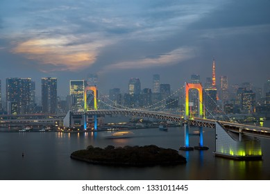 View of Tokyo Bay with Rainbow bridge and Tokyo Tower landmark Twilight scene, Odaiba, Japan.