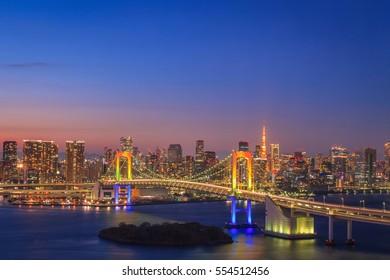View of Tokyo Bay, Rainbow bridge and Tokyo Tower landmark, Twilight scene, Odaiba, Japan