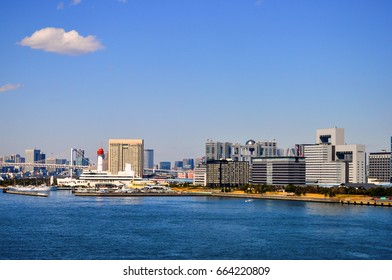 view of Tokyo city  with industrial port from water.