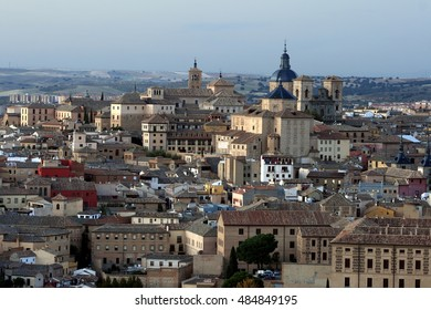 View of toledo at dusk, Castilla La Mancha, Spain, unlit, only ambient lights, next to the River Tagus,