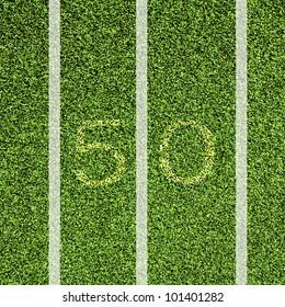 View top of 50 yard line on American football field.