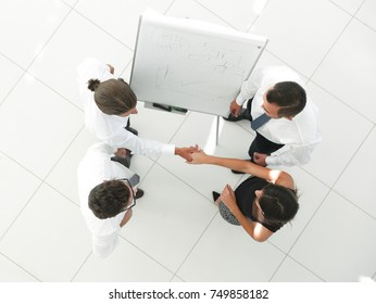 view from the top. the background image of a business handshake colleagues