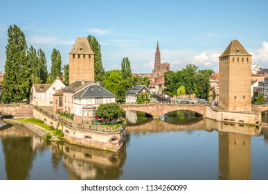 View from the top of the Barrage Vauban, two of the  towers on the Ponts Couverts over the river Ill and the Cathedral de Strasbourg in the background. Petit France, Strasbourg, Alsace, France
