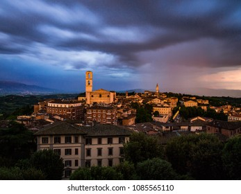 View from the top of the beautiful city of Perugia in Italy during a storm, with the sky full of swollen nuvele and sweets and the last ray of sunshine that illuminates the cathedral and the bell towe