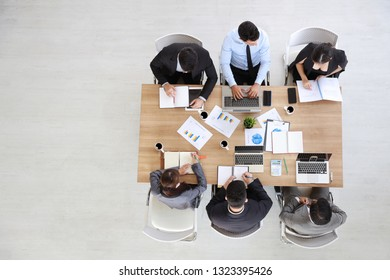 view from the top of business people in meeting room with copy space