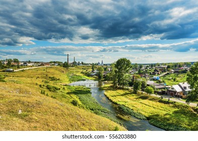 The view from the top of the cliff to the village of Novoutkinsk, the river Chusovaya on a summer day. Russia, The Urals