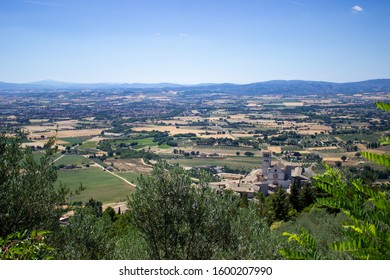 View from the top of Cortona, in the Arezzo province in Italy. Gorgeous landscape with Italian houses, fields, mountains, and the blue sky.