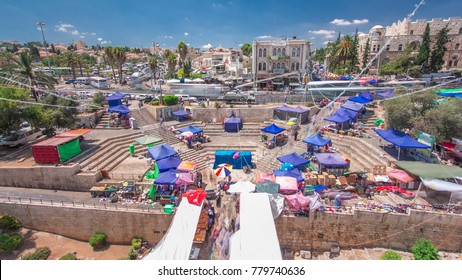 View from the top of Damascus gate to Jerusalem Old Town timelapse. Israel. Blue cloudy sky, walking people and traffic on the road