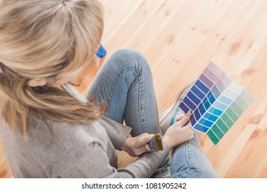 view from top female sitting on floor with color palette selecti