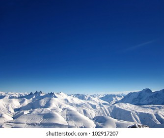 View from Top of French Alps Winter Ski Resort Scenic Highest Point 3300m above sea level with blue sky on sunny day