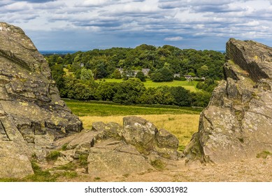 A view from the top of the hill with Old John folly framed by 560 million year old Charnian rocks in Bradgate Park, Leicestershire, towards Warren Hill