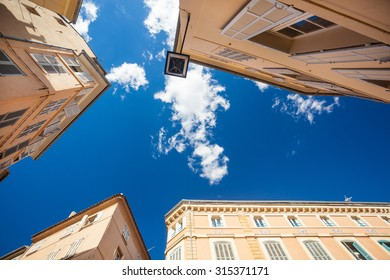 View at top of the houses and blue sky with clouds at Aix-en-Provence, France