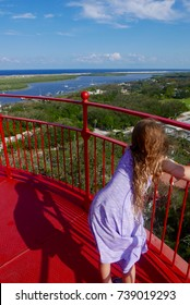 View from the top of a lighthouse with a young girl int he foreground