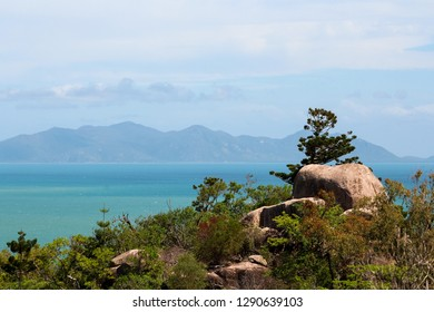 View from the top of Magnetic Island during a hike with blue ocean and green vegetation (Magnetic Island, Townsville, Queensland, Australia)