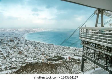 View from the top of Mount Hakodate in winter snow - Famous ropeway Mountain at the top of Mount Hakodate in Hokkaido Japan