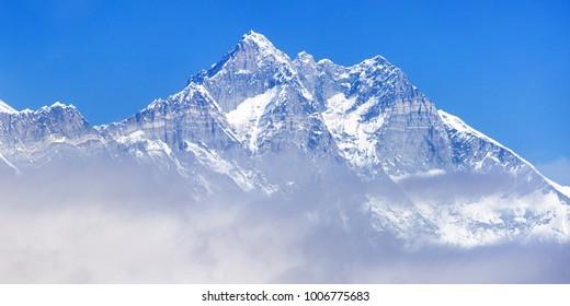 View of top of mount Lhotse south rock face blue colored, Sagarmatha national park, Khumbu valley, Nepal Himalayas