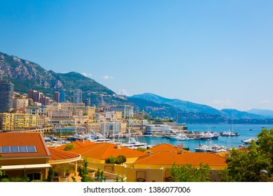 View from the top of mountain, in background is Port of Monaco, big ships and houses. Amazing landscape, blue sky and sea. Summer time.