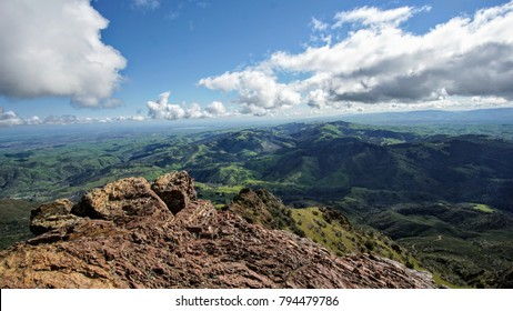 view from top of mt diablo in California. looking out at green hills and clouds.