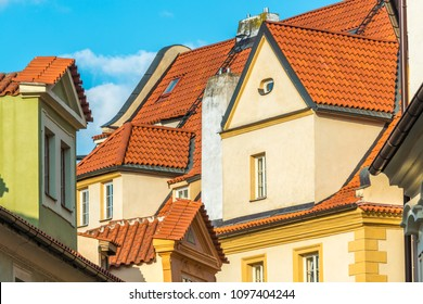 View of the top of old buildings with red roof and blue sky at Prague city Czech republic.