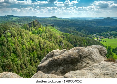 View from the top of Rock of Rudolf, or Rudolfstein, or Rudolfuv kamen, towards Rock of Maria in beautiful summer landscape of Bohemian Switzerland. Summer vacation in central Europe. - Shutterstock ID 1989334052