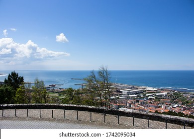 The view from the top of the Santa Luzia hill. Aerial view of Estaleiros Navais de Viana do Castelo (ENVC shipyard), Limia River and the Atlantic Ocean in Northern Portugal.
